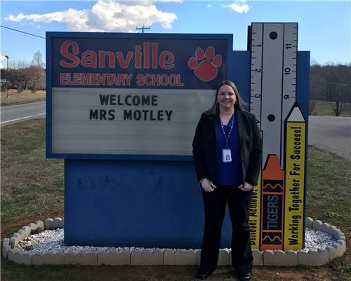 Liz Motley with Sanville Sign