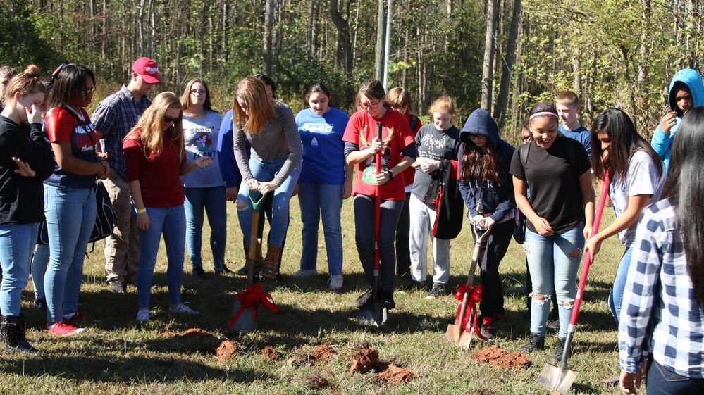 Warrior Tech Language of Life students begin to dig their community garden.