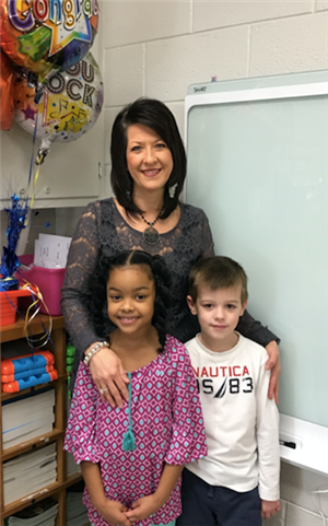 Mount Olivet Teacher of the Year Deitra Cassell standing proudly with two of her students.